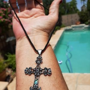 Antiqued cross necklace. Twisted cord